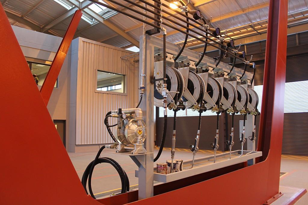 Enrolladores abiertos en pórtico y aspiración de aceite usado
